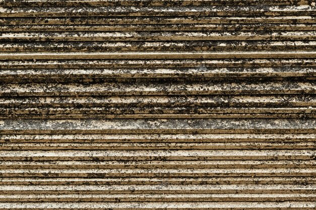 The side view of asbestos cement roofing sheets stack.